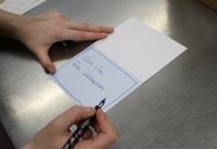 handschriftliches-beschreiben-der-gruskarte